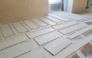 Priming furniture before repainting it.